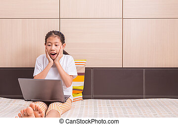 Happy asian girl using computer laptop notebook with...