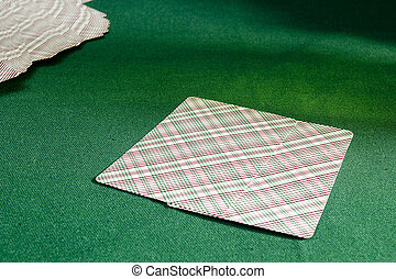 Playing cards on the table with green cloth - Playing cards...