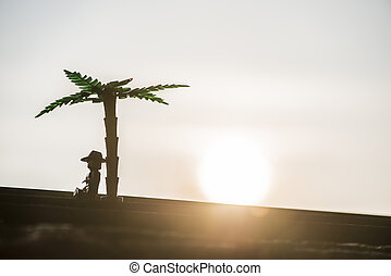 Figures of palm tree and man