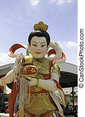 Kim settling - A statue of Kuan Yin devotees Which coincided...