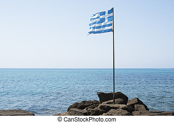 Greek flag on the bach.