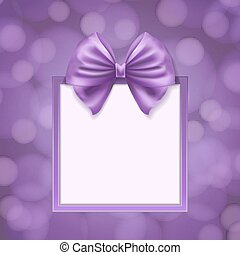 square box frame with violet ribbon on abstract blurry...