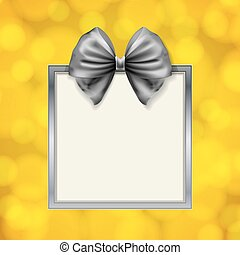 shiny bow and square box frame on blurry golden background...