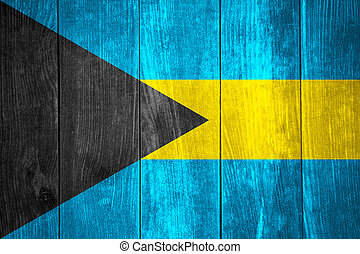 flag of Bahamas or Bahamian banner on wooden background