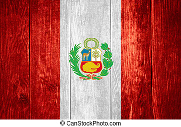 flag of Peru or Peruvian banner on wooden background