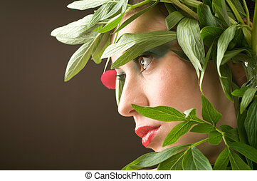 Naturaly beauty - Beautiful caucasian woman with leaves of...