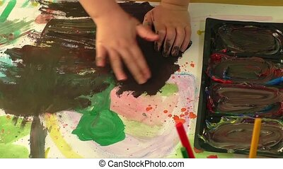 Creative paint art with little hand of a young girl....