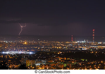 Lightning storm over city at night - Lightning storm over...