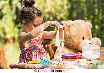 Beautiful girl baking cookies - Happy little chef girl...