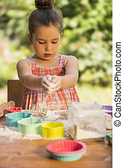 Little Girl Baking Cookies - Happy little chef girl smeary...