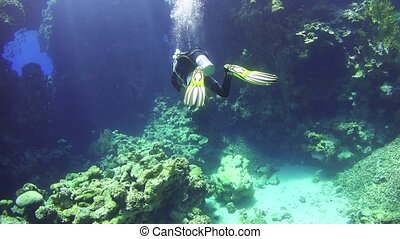 Diver Swim Through Underwater Cave, Red Sea