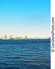 Ships near Benjamin Franklin bridge over Delaware River in Philadelphia