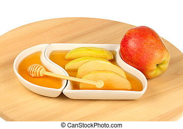apples and honey - Dipping apples in honey for Rosh HaShana,...