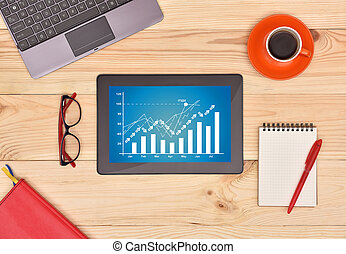 finance growth chart - Touch pad with finance growth chart...
