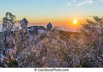 sunrise under the winter calm mountain landscape with...