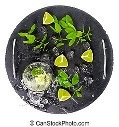 mojito cocktail with splash, ice, green mint, cuted limes...