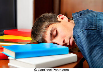 Teenager sleep with a Books - Tired Teenager sleep on the...