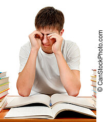 Tired Student with the Books - Tired Teenager Rub the Eyes...
