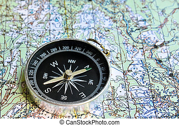 Travel and adventure The magnetic compass lies on a...