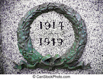 green wreath on war memorial with the years 1914 and 1919