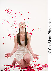 Flying petals - Caucasian woman throw petals of red roses