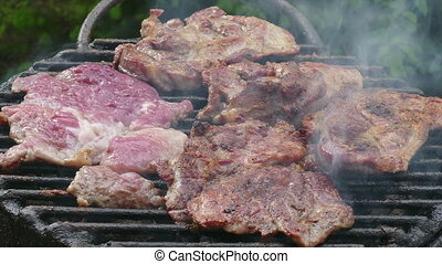 Pork meat grilling zoom in video - Steak grilling at...