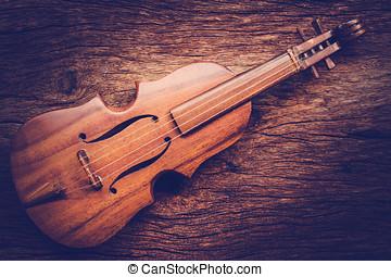 Violin on grunge dark wood background