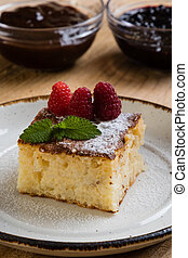 baked rice pudding with rasberry - traditional homemade...