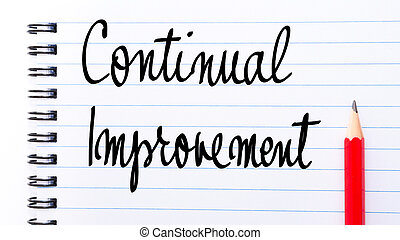 Continual Improvement written on notebook page with red...