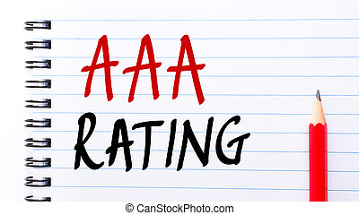 AAA Rating written on notebook page with red pencil on the...