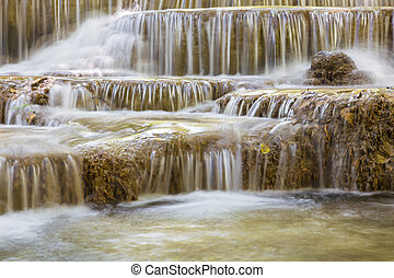 Deep forest blue stream waterfalls close up, natural...