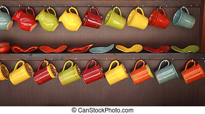 Row of colorful mugs - Two rows of colorful ceramic mugs...