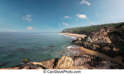 Paradise beach with stones and palm trees, aerial view...