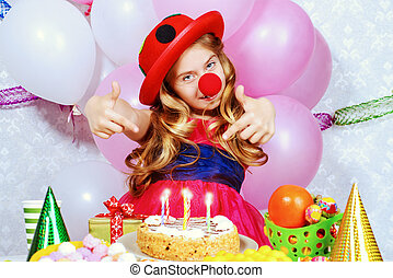 blow out the candles - Cute happy child girl enjoys her...