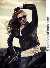 independence - Sexual biker woman wearing black leather...