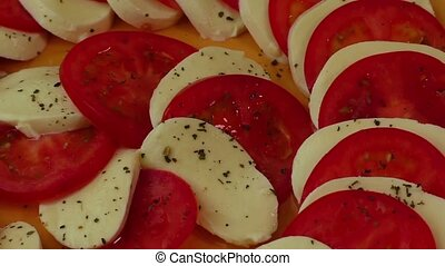 Delisious salad with mozzarella cheese and sliced tomatoes...