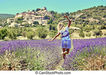 Young woman raised her hands up in lavender