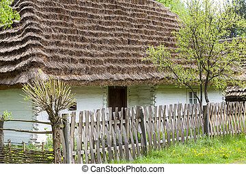 old traditional wooden polish cottage in open-air museum,...