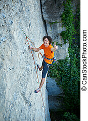 male rock climber on the cliff - male rock climber rock...