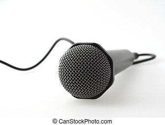 Microphone - Lonely cabled microphone over white background