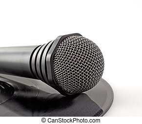 Microphone over vinyl - A lonely black microphone over a...