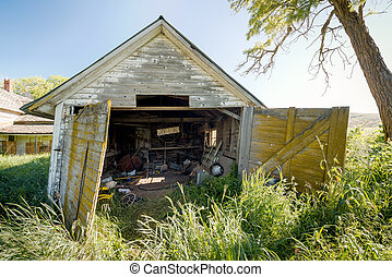 Old wood garage with wide load sign in it