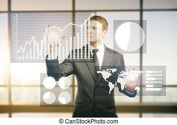 Businessman managing business charts on interior background