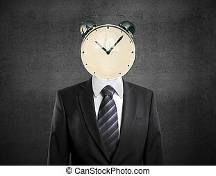 Time management concept with alarm clock headed businessman...