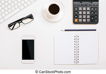 Office desktop with items - Top view of white office desktop...