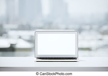 Desktop with white laptop - Front view of table with blank...