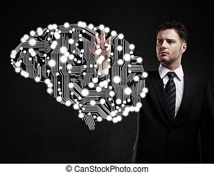 businessman presses circuit board in form of human brain
