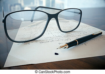 Eyeglass on mathematical formulas - Closeup of wooden table...