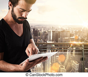 Stay connected with the world - Man touches the tablet with...