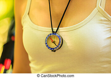 Woman with compass pendant - Outdoor equipment survival...